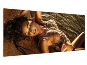 Slika žene koja leži na plaži (V020827V10040)